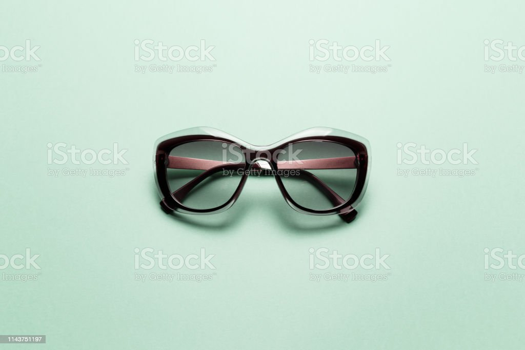 Sunglasses on Mint background. Top view. Flat lay. Minimal style with...