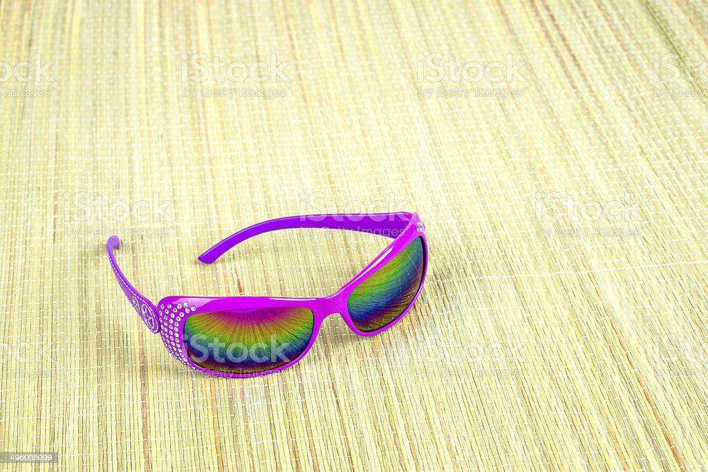 Sunglasses on straw mat stock photo