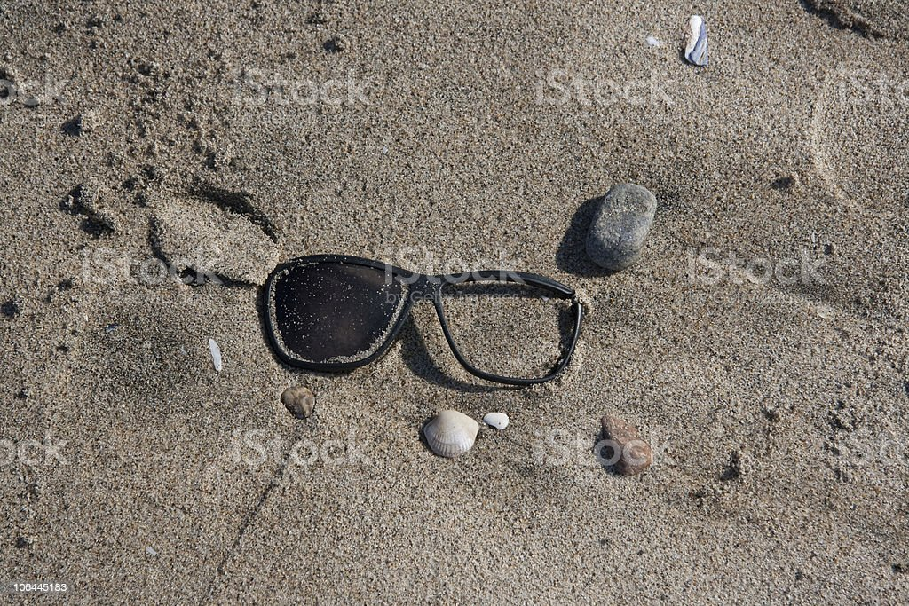 Sunglasses on the beach stock photo