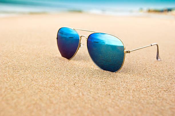sunglasses on the beach stock photo