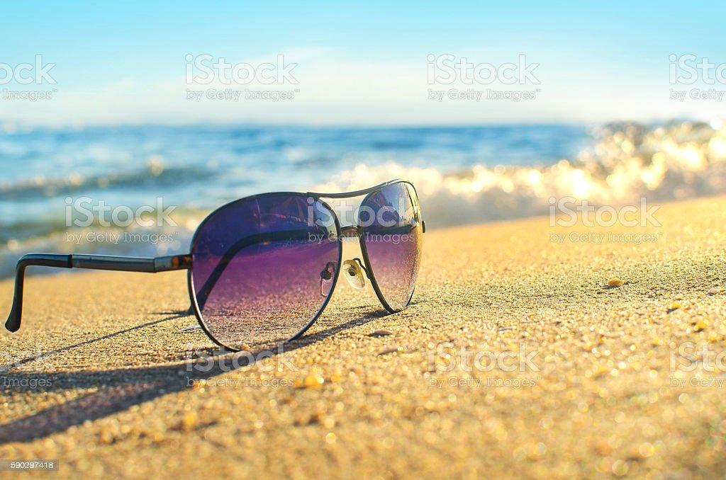 Солнцезащитные очки на пляже  Стоковые фото Стоковая фотография