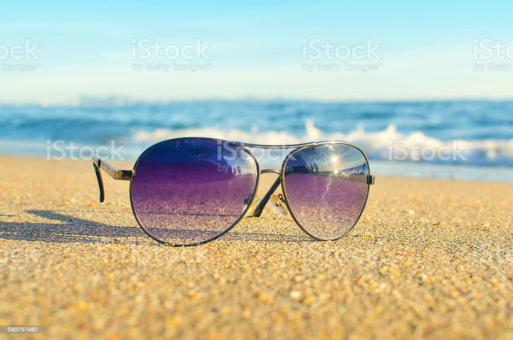 Sunglasses on the beach royaltyfri bildbanksbilder