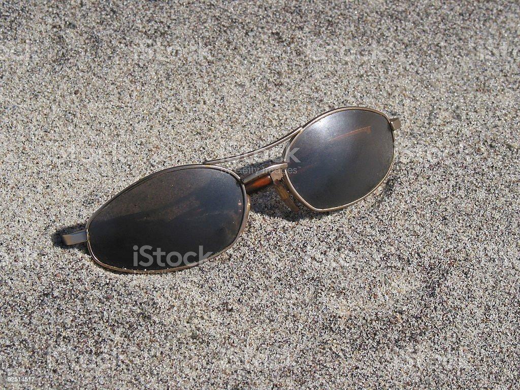 Sunglasses on the beach royalty-free stock photo