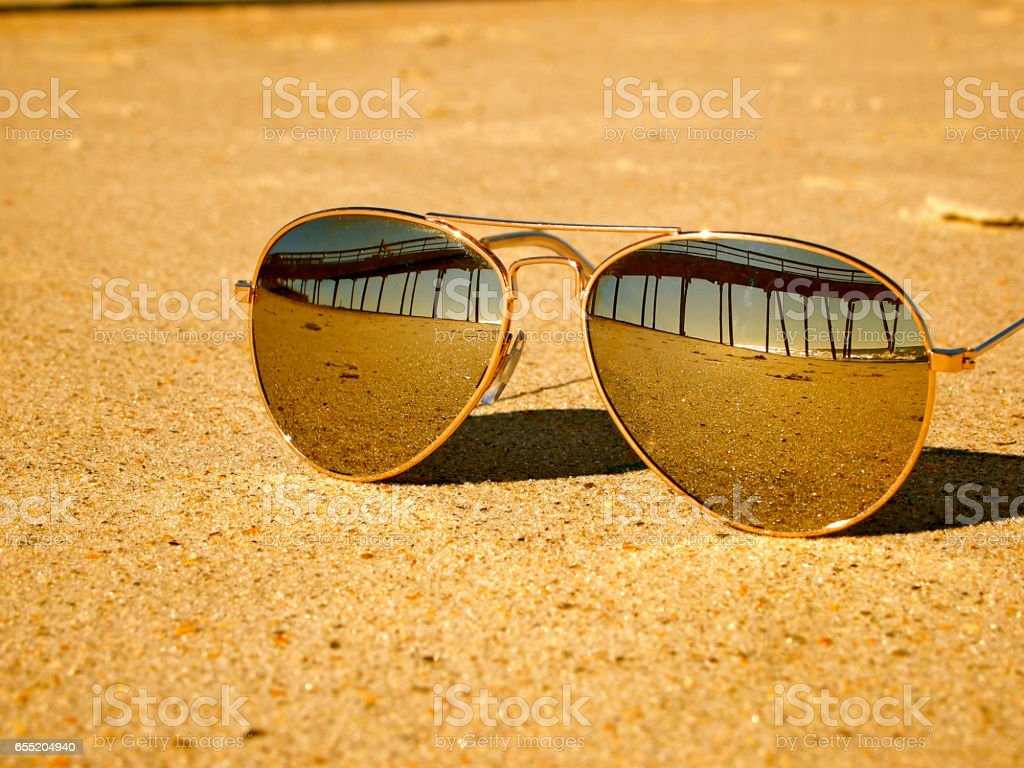 Sunglasses on the Beach Reflection stock photo