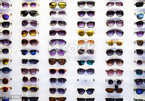Sunglasses on the shop window, plenty of choice of sunglasses for sale.