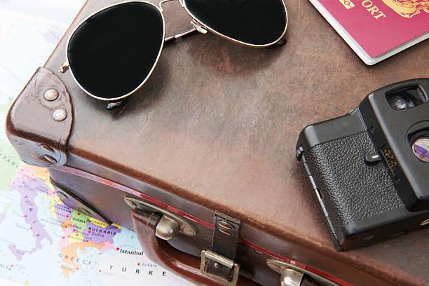 Sunglasses passport and camera on vintage suitcase picture id180714509?b=1&k=6&m=180714509&s=612x612&w=0&h=fde4xk3n6bjykcvjbzv2r4d9uqtlbgsvsiqsjws8tgi=