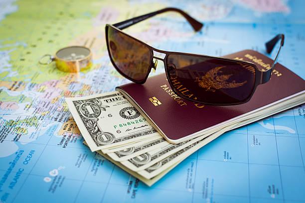 Sunglasses passport money and compass on the map picture id542792742?b=1&k=6&m=542792742&s=612x612&w=0&h=jkujql0c6xtfzstyf8fo4upyqlnd1tnrqm0nc50f7bs=