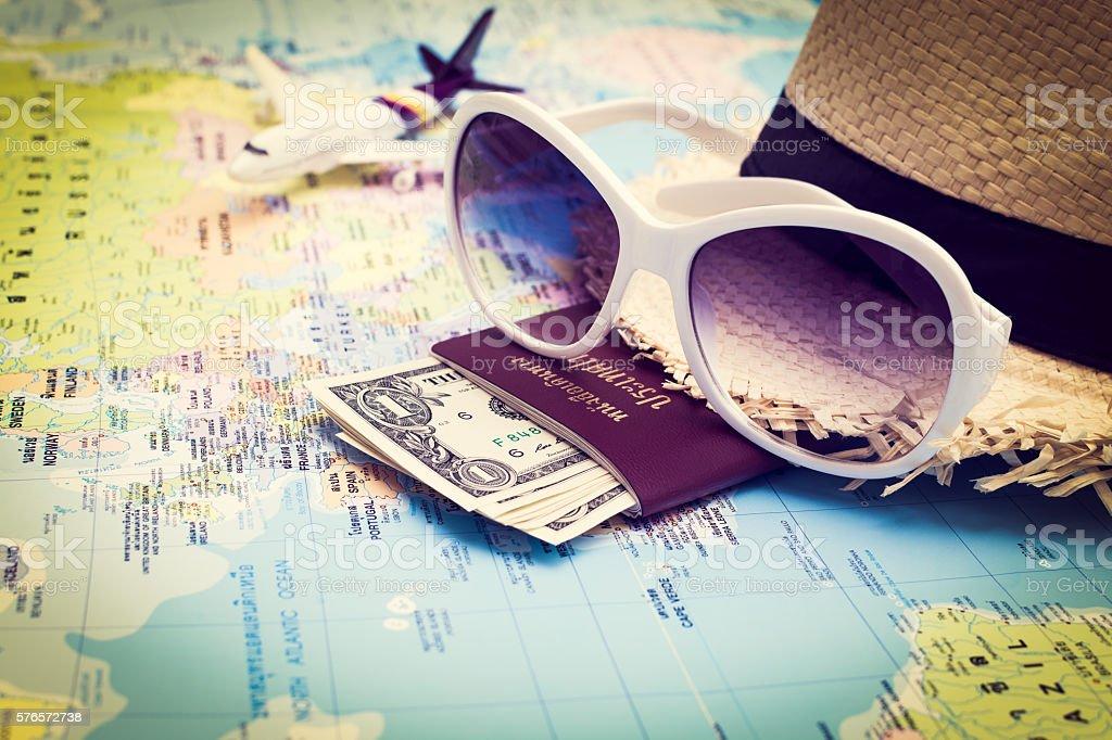 Sunglasses, Passport, Money, Hat and aircraft on the world map stock photo