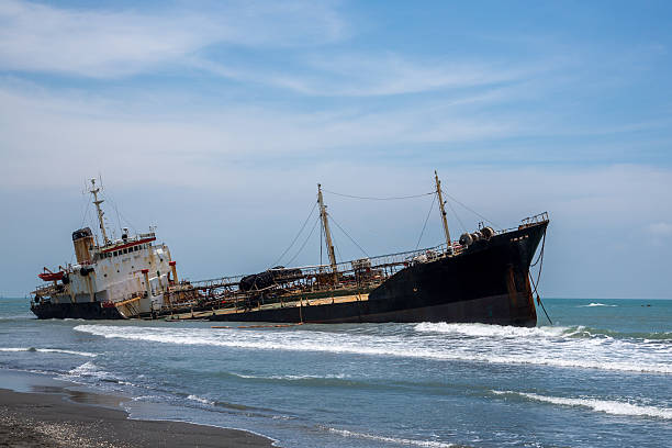 sunken boat at beach - stranded stock pictures, royalty-free photos & images