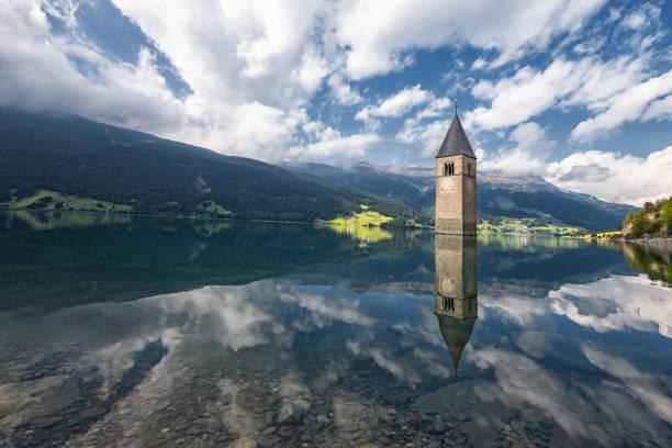 Sunken church in lake Reschen reservoir in Italy stock photo