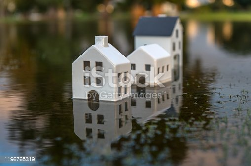 Submerged houses product of global warming. Conceptual image of the rise in the level of the seas on planet Earth.