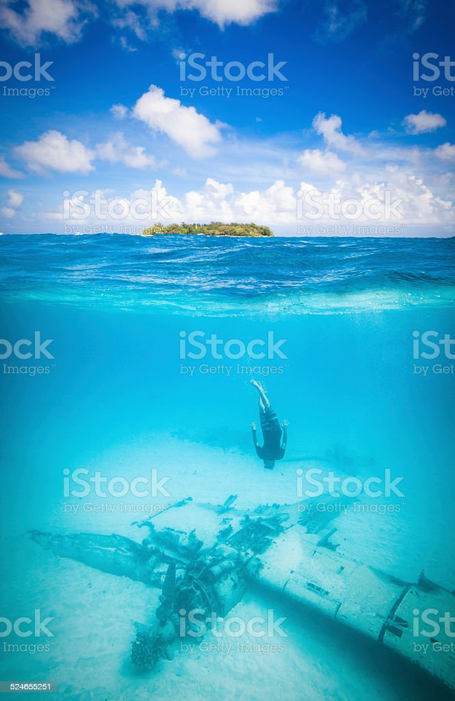 Sunken plane in paradise stock photo