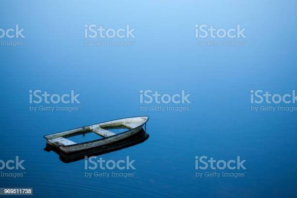 Photo of sunken rowboat in lake