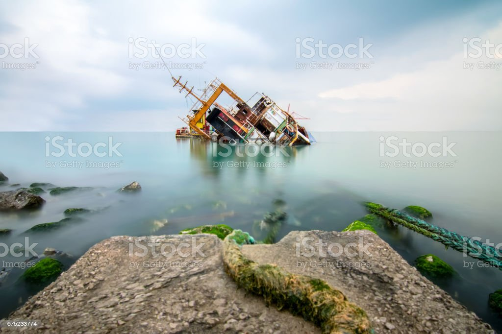 A sunken wreck rusting into the sea royalty-free stock photo