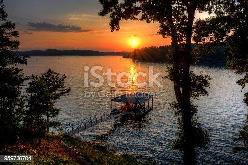 Sunset over lake and boathouse.