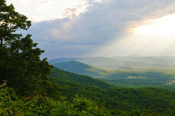 Sunlight after a rain in the Shenandoah Valley of Virginia Rays of sunlight after a rain in the Shenandoah Valley charlottesville stock pictures, royalty-free photos & images