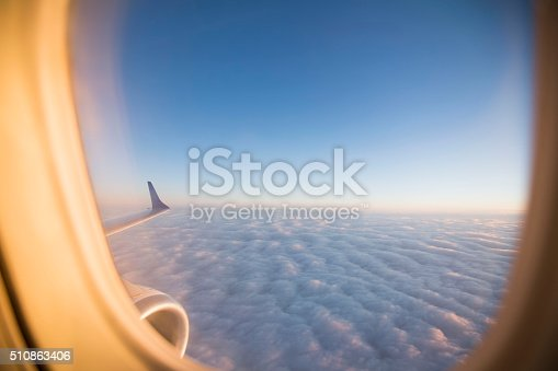 istock Sunlight and clouds from the porthole on airplane 510863406