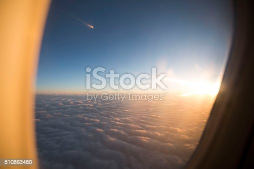 istock Sunlight and clouds from the porthole on airplane 510863480
