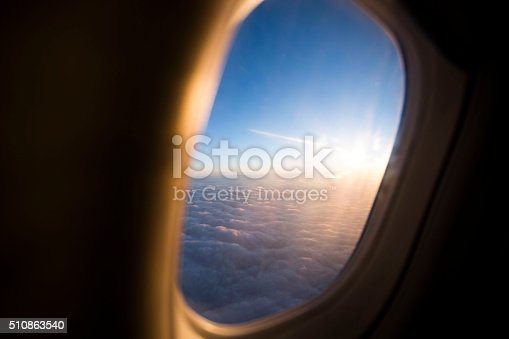 istock Sunlight and clouds from the porthole on airplane 510863540