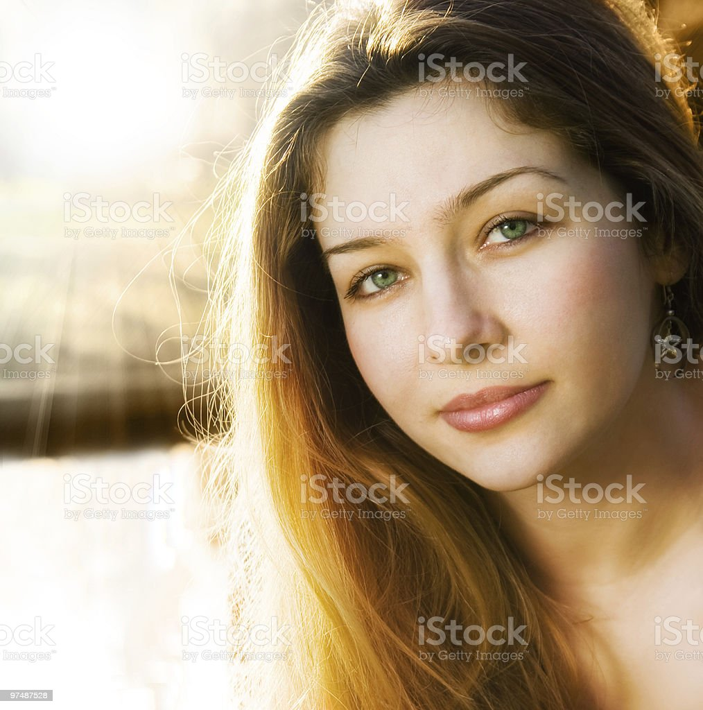 Sunlight and one beautiful sensual young woman royalty-free stock photo
