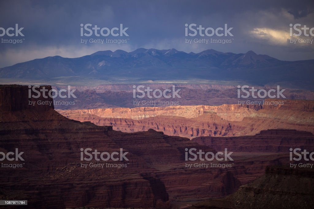 Sunlight and Storms Over the La Sal Mountains and Canyonlands National Park stock photo