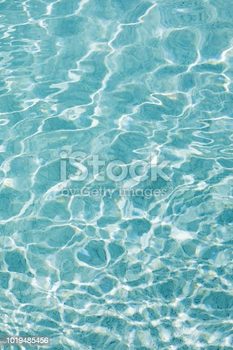 Sunlight and surface of a swimming pool