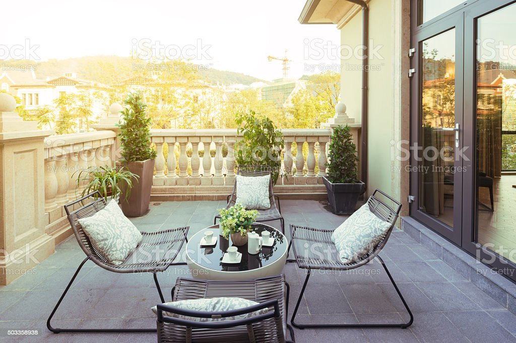 sunlight and table and chairs in modern balcony stock photo