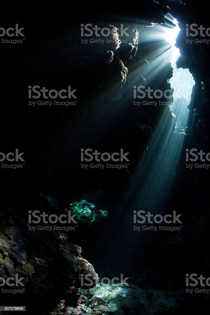 Sunlight and Underwater Cavern stock photo
