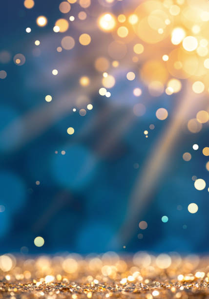 sunlight beam on gold defocused sparkles - brightly lit stock pictures, royalty-free photos & images