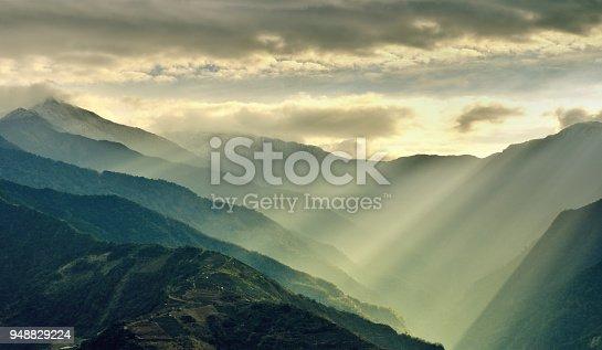 Sunlight beams through the fog on mountain at morning, Hehuan Mountain, Taiwan.