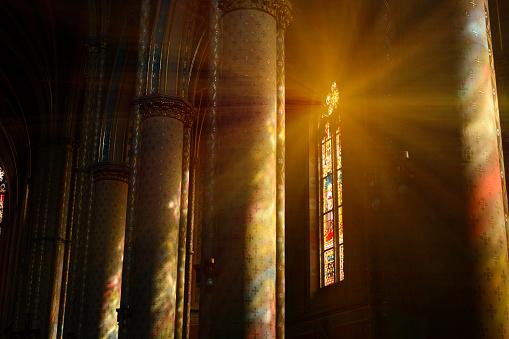 Sunlight between the columns in catholic church