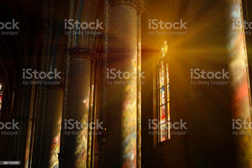 Sunlight between the columns in catholic church stock photo