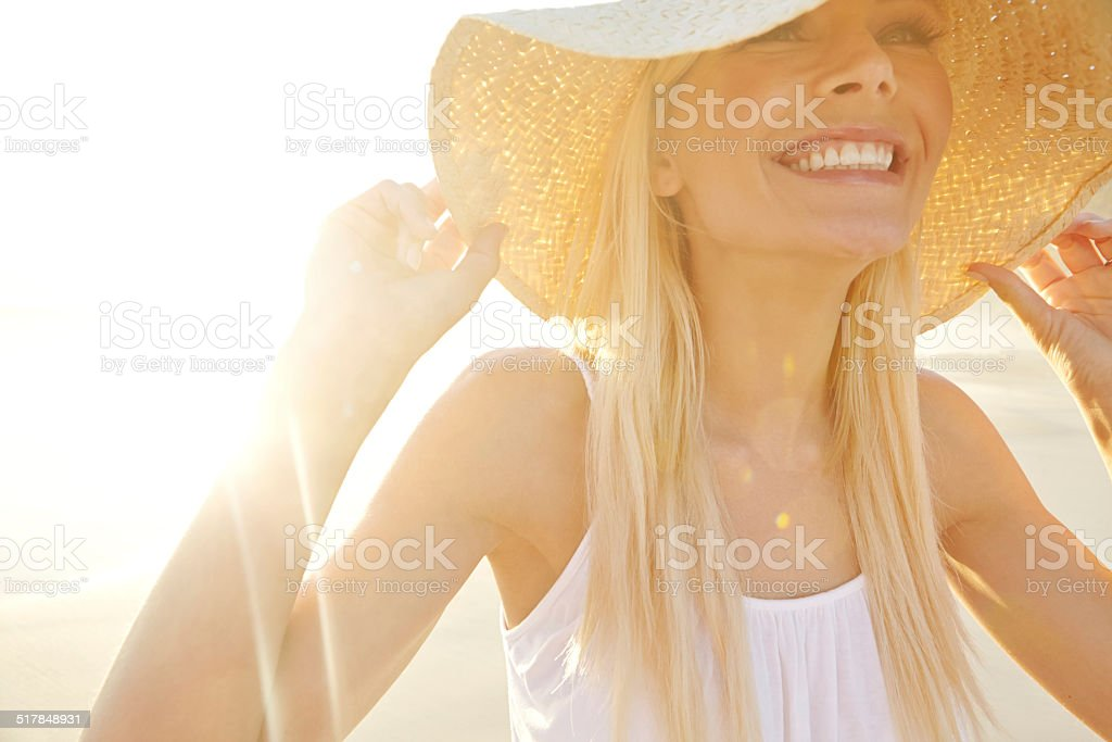 Sunlight brings a smile to her face stock photo