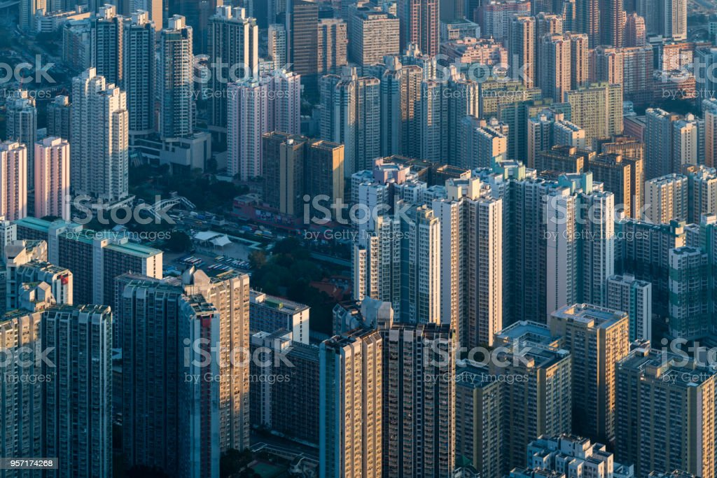 sunlight casting on city buildings in a warm sunset stock photo