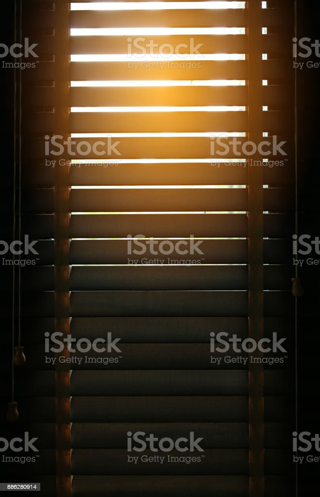 Sunlight coming through venetian blinds by the window. stock photo