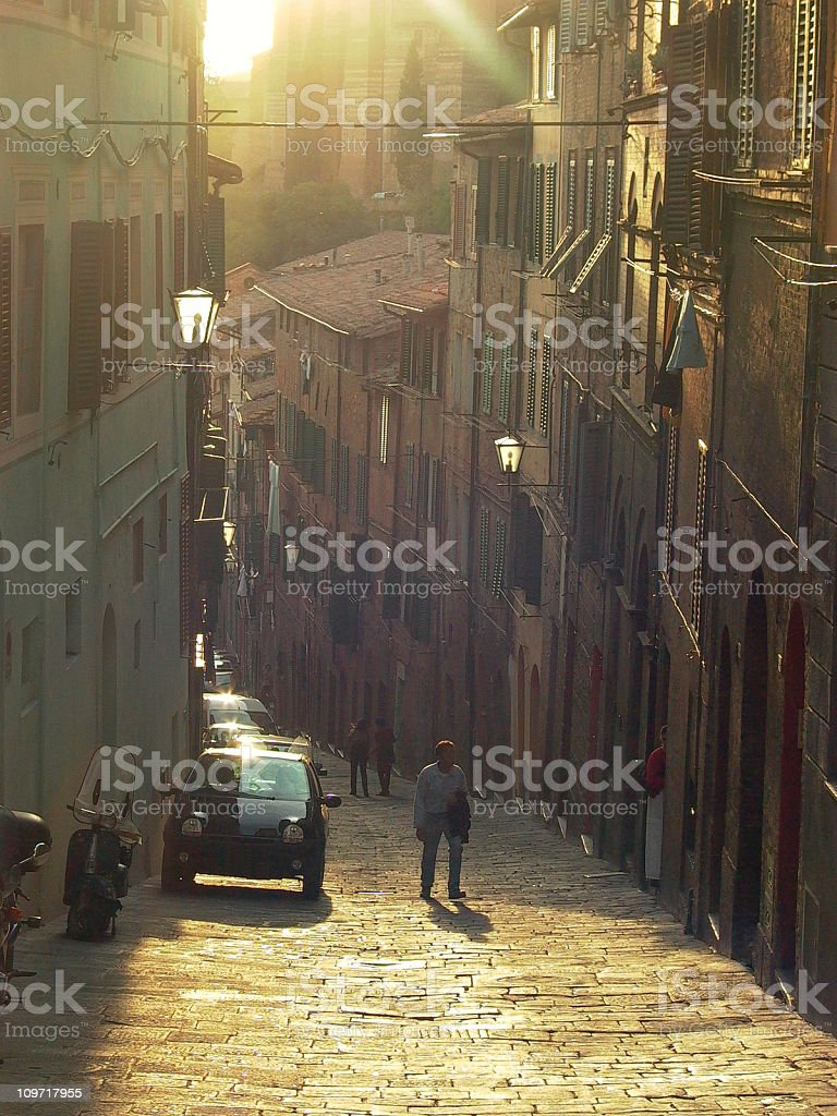 Sunlight flaring over a cobbled street stock photo