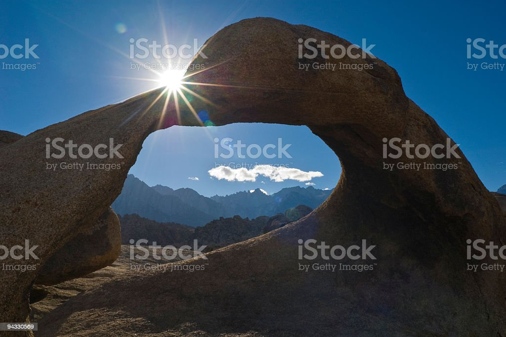 Sunlight flaring over arch royalty-free stock photo