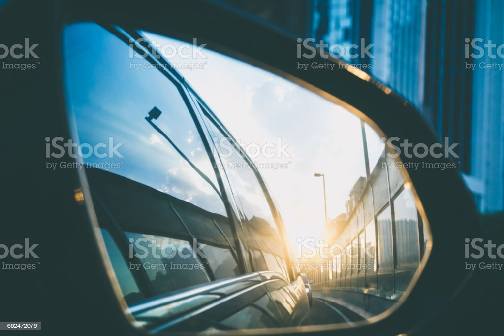 Sunlight from driving mirror stock photo
