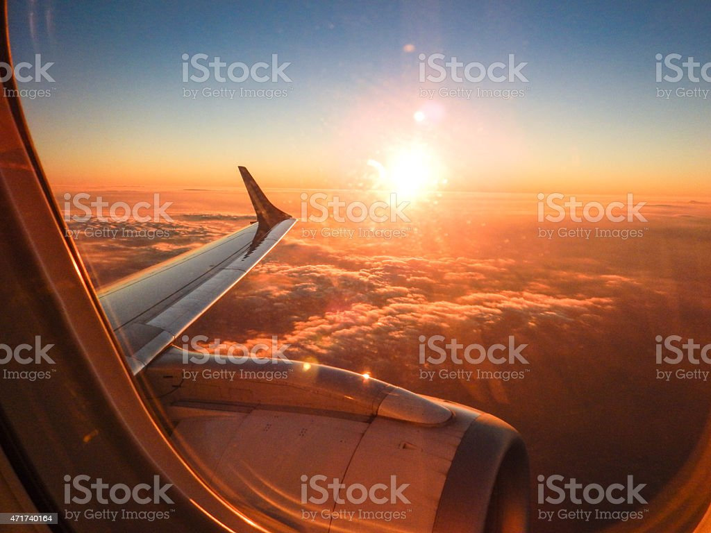Sunlight from the porthole on airplane stock photo