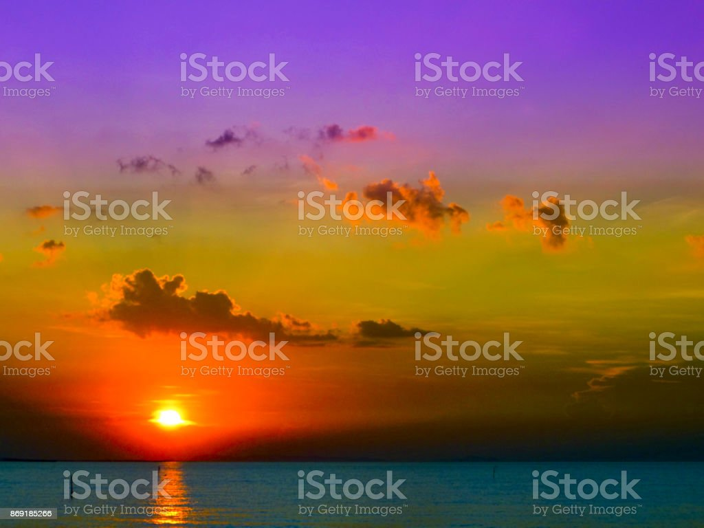 sunlight of sunset on the sea in evening and the purple sky