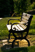 a picture of sunlight on a park bench in Highland Park Rochester New York