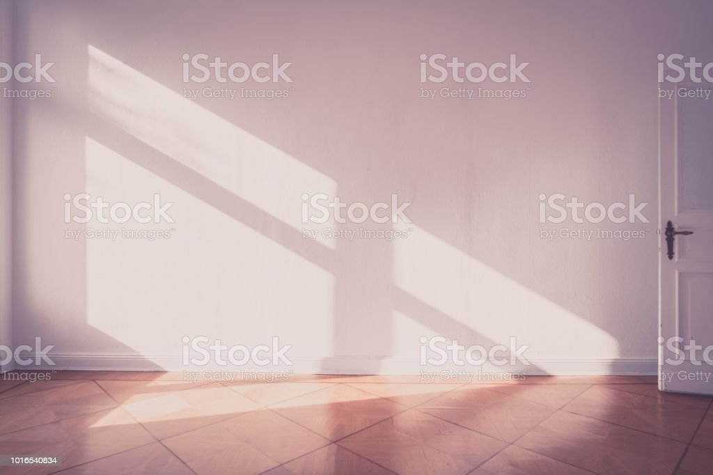 sunlight on apartment wall - empty room old photo style - stock photo