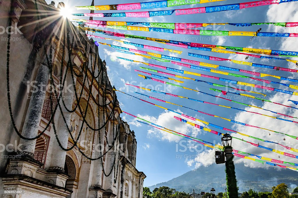 Sunlight on church & volcano near Antigua, Guatemala stock photo