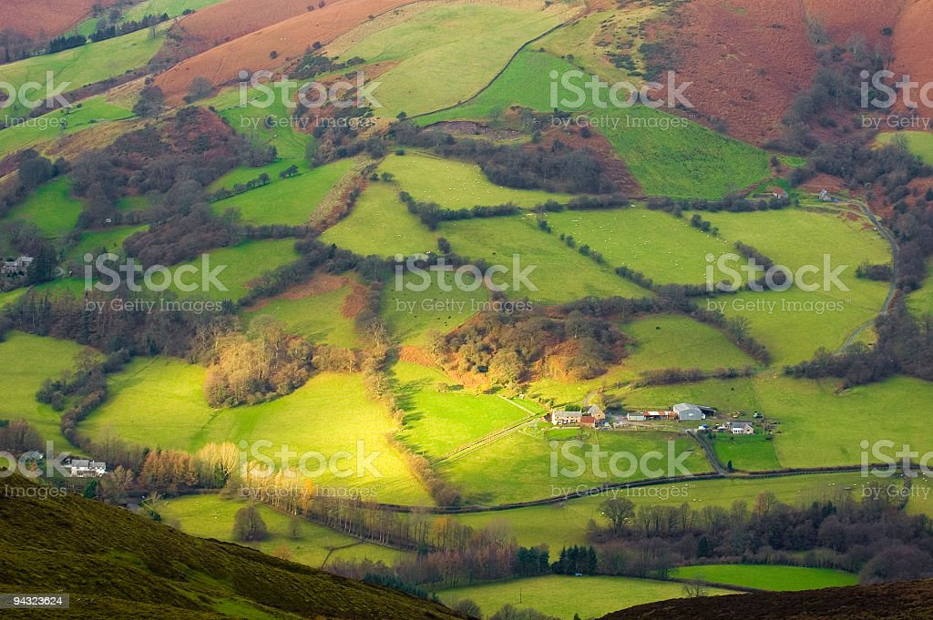 Sunlight on green mountain farm royalty-free stock photo