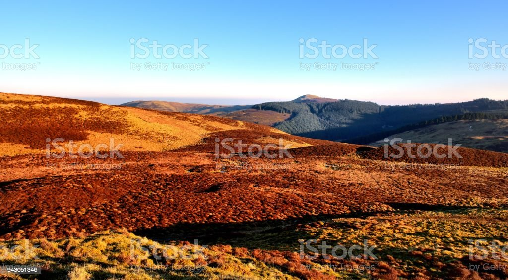 Sunlight on Lord's Seat and Broom Fell stock photo