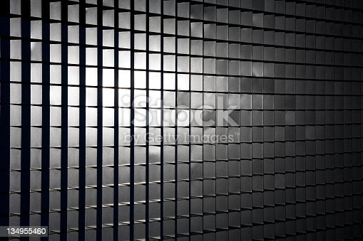 Sunlight reflected through a box-section metal grid. Great background or texture. Full-color image. Camera: Canon 5D.