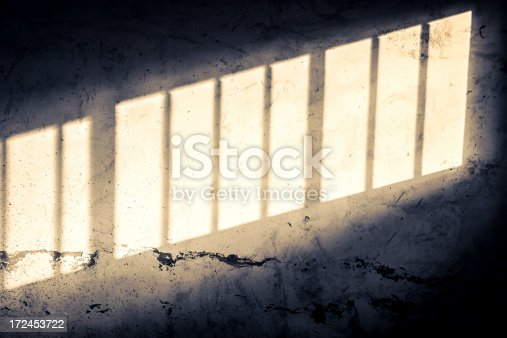 Sunlight on old wall of abandoned house.