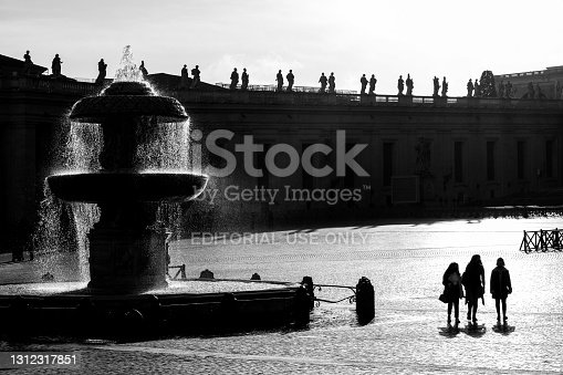 istock Sunlight passes through one of Bernini's fountains in the square of St. Peter's Basilica 1312317851