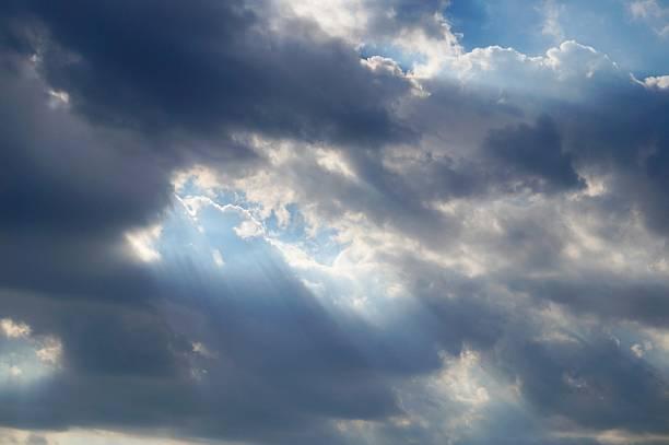 sunlight penetrating through clouds - penetrating bildbanksfoton och bilder