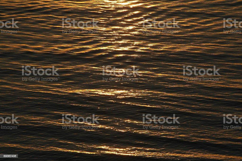 Sunlight reflection off ocean royalty free stockfoto